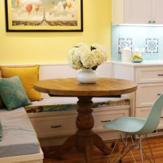 Yellow Breakfast Nook With Banquette Seating