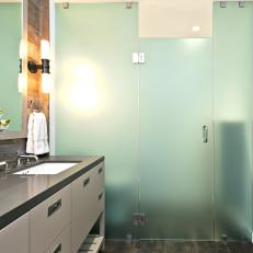 Bathroom With Opaque Glass-Enclosed Shower