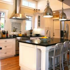 Transitional Kitchen With Industrial Pendants Over Island