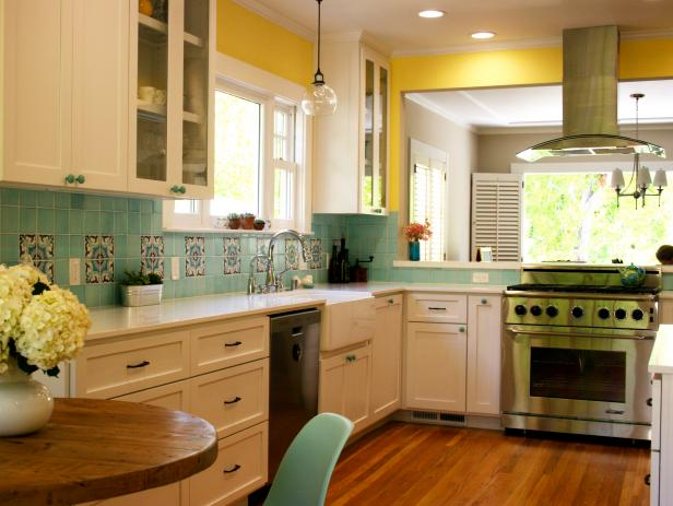 Yellow and Turquoise Kitchen With White Shaker-Style Cabinets
