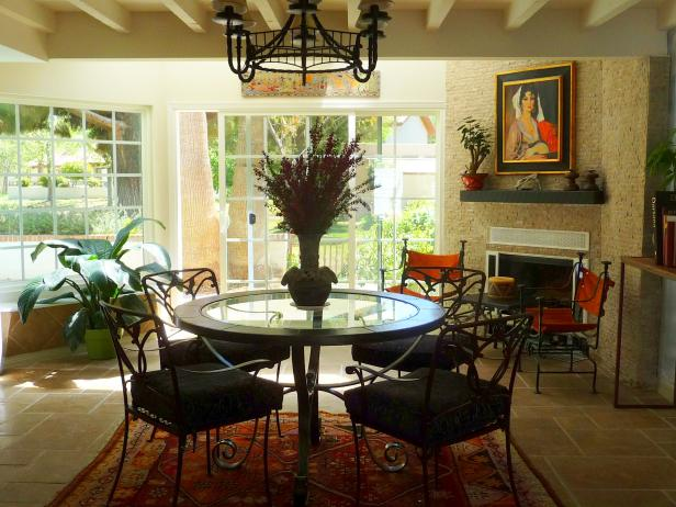 Southwestern Dining Space Featuring Fireplace and Black Chandelier