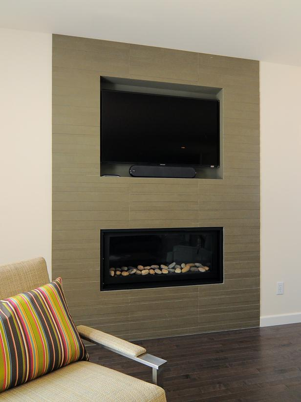 Brown Tile Inset With Fireplace and Flat-Screen TV