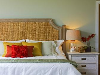 Green Bedroom with Wicker Bed and White Duvet