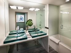 Deep Teal Sinks Stand Out in Modern Bathroom