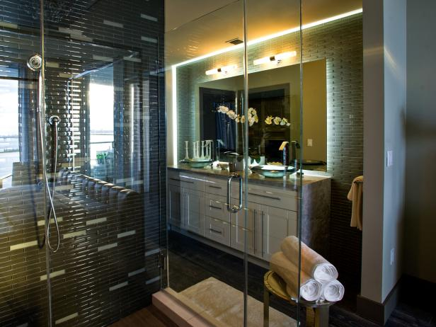 Bathroom With Glass Shower, Black and Gray Tile and Double Vanity