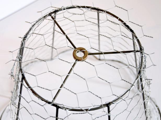 Cut a piece of chicken wire to fit on top of lampshade frame.