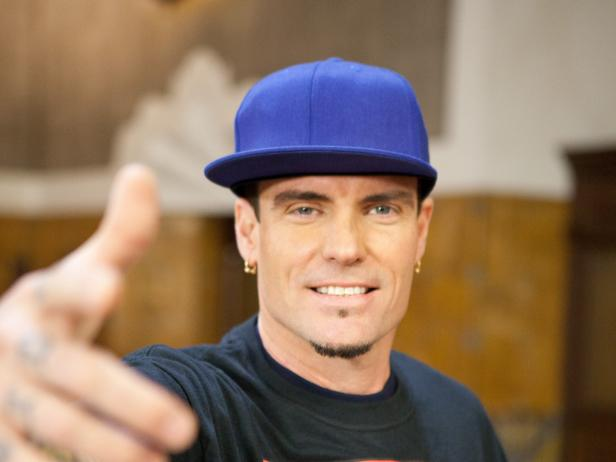 Vanilla Ice points to the camera