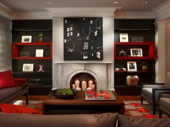 Red and Black Living Room With Custom Cabinetry
