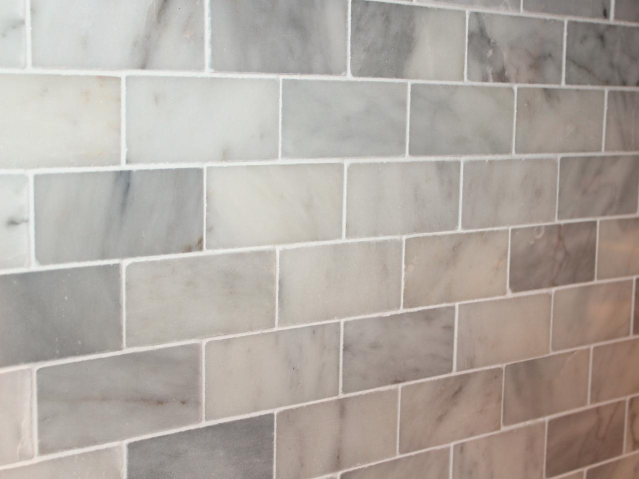 fill in gaps with grout to complete backsplash
