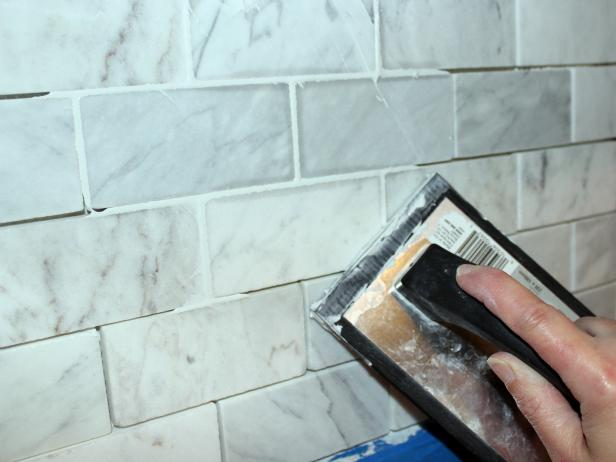Apply Grout to Marble Tile Kitchen Backsplash