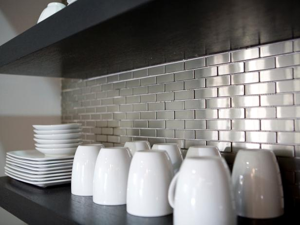 Stainless steel backsplash with floating shelf