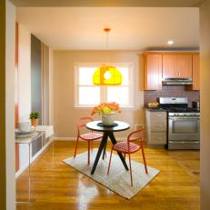 Cheery Contemporary Kitchen With Bistro-Style Dining Area