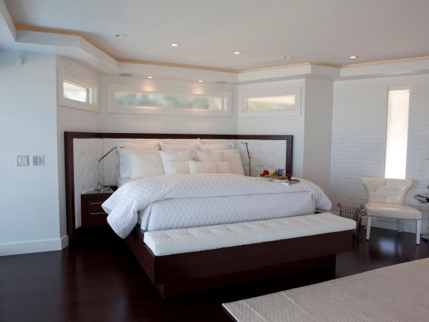 White Modern Bedroom With Dark Floors and Platform Bed