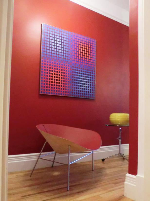 Vibrant Red Hallway With Contemporary Chair and Modern Art