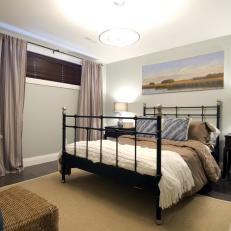 Serene Basement Bedroom With Elongating Curtains