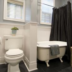 Renovated Bathroom With Beadboard Panels and Blue-Gray Walls