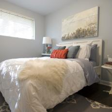 Serene Bedroom With Pale Blue Walls & Coastal Painting