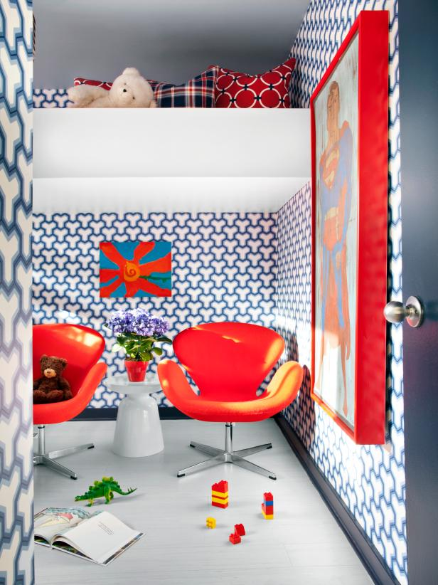 Boy's Bedroom With Geometric Blue-and-White Wallpaper and Red Chairs