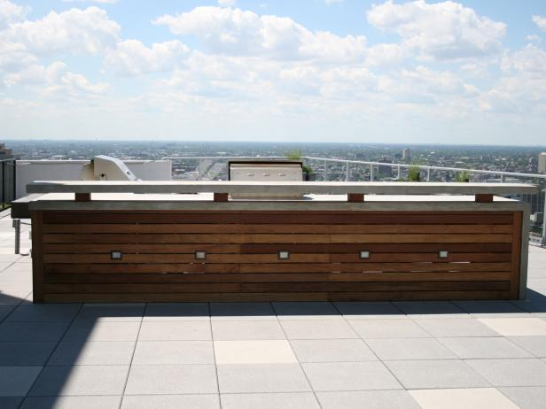 Wooden Bar on Rooftop With City View