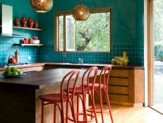 Eclectic Teal Kitchen With Gold Pendant Lights