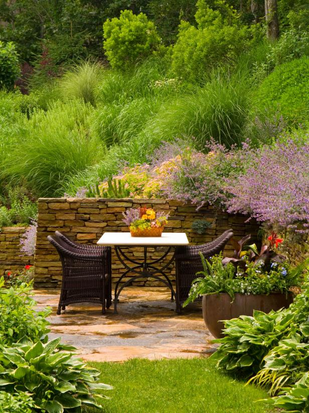 Patio With Wicker Chairs and Natural Landscaping
