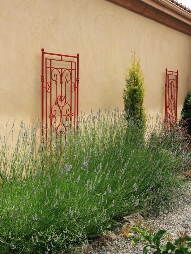 Mediterranean Exterior With Flower Bed and Red Accents