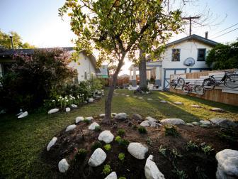 Raised Rock Garden in Backyard With Bike Art