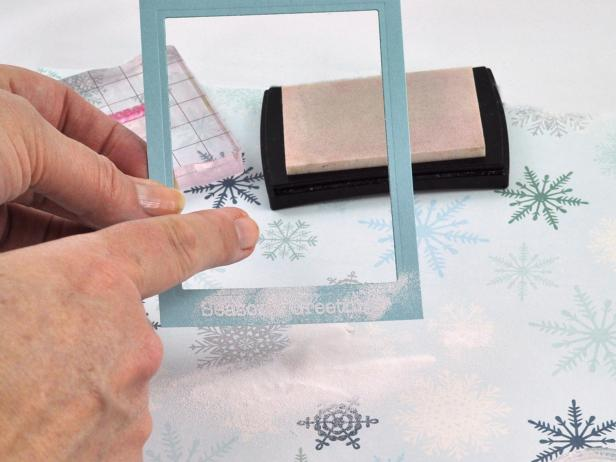 Using watermark ink, stamp sentiment onto bottom of frame then sprinkle white embossing powder onto watermark ink.
