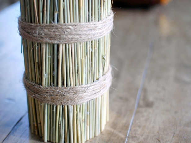 To finish your centerpiece, wrap twine around the base of the wheat bundle. Secure with a small amount of glue, then display. This look fits in perfectly with fall decor.