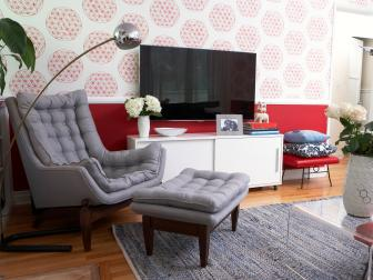Bold Red Living Room With Gray Tufted Chair and Ottoman