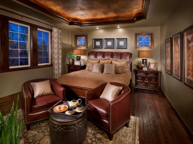 Bedroom With Leather Headboard and Chairs