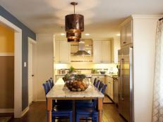 Neutral Traditional Kitchen With Bright Blue Chairs