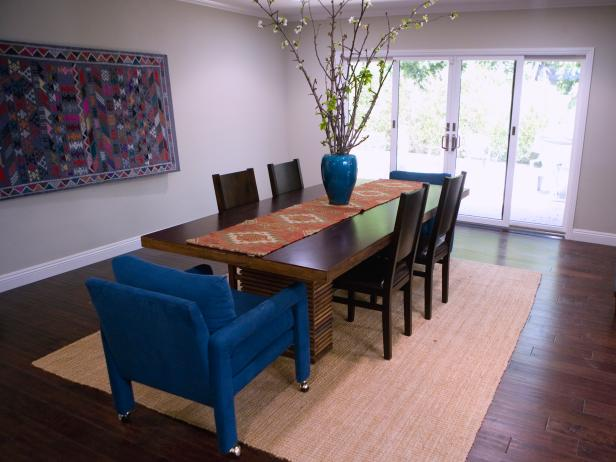Blue upholstered arm chairs in the dining room