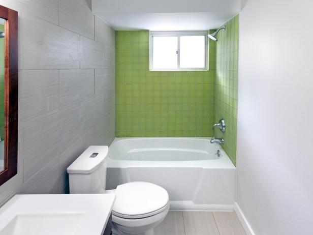 Neutral Bathroom With Green Backsplash in Shower and Tub