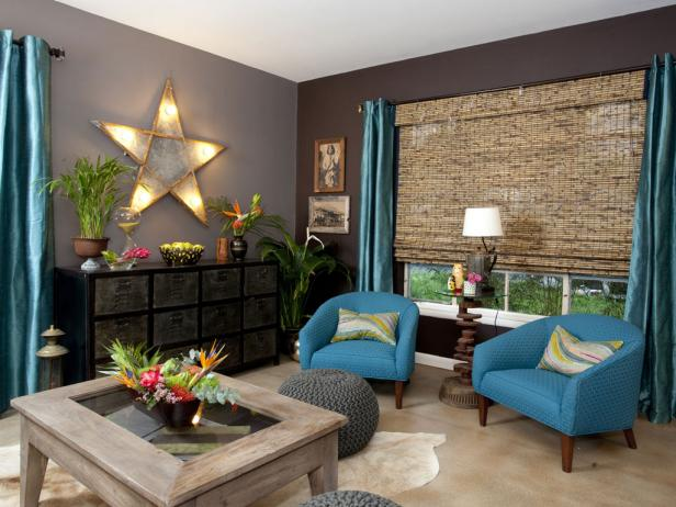 Eclectic Living Room With Storage Shelf, Blue Armchairs and Star Light