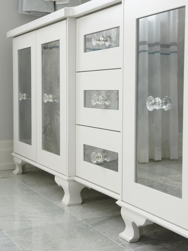 White Master Bathroom vanity with inlaid glass door fronts
