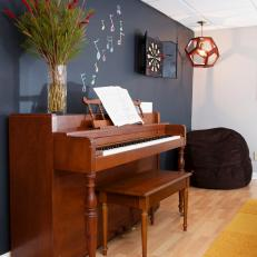 Basement Playroom With Chalkboard Wall and Piano