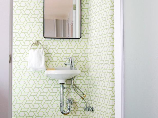 Small Powder Room With Graphic Wallpaper and Wall-Mounted Sink