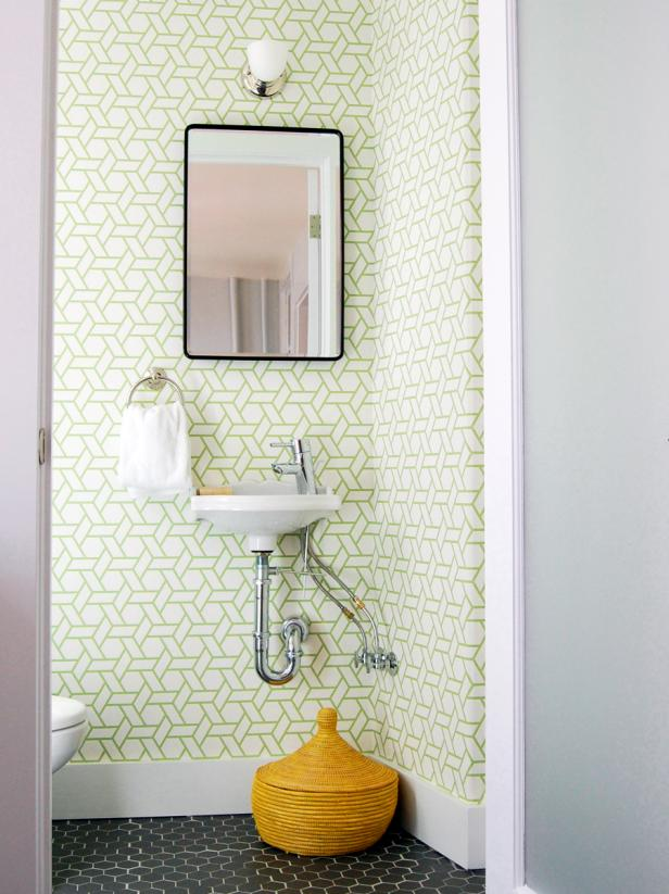 Tropical-Inspired Power Room with Wall-Mounted Sink
