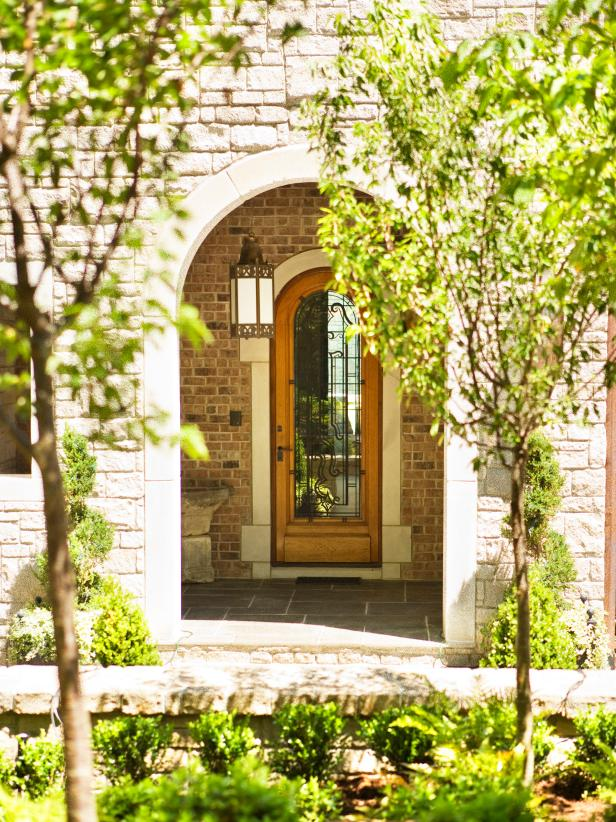 Exterior Stone Archway With Wooden Front Door