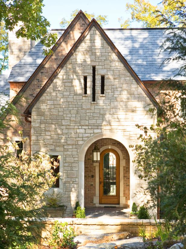 English Country Manor Home With Stone Exterior and Arched Entry