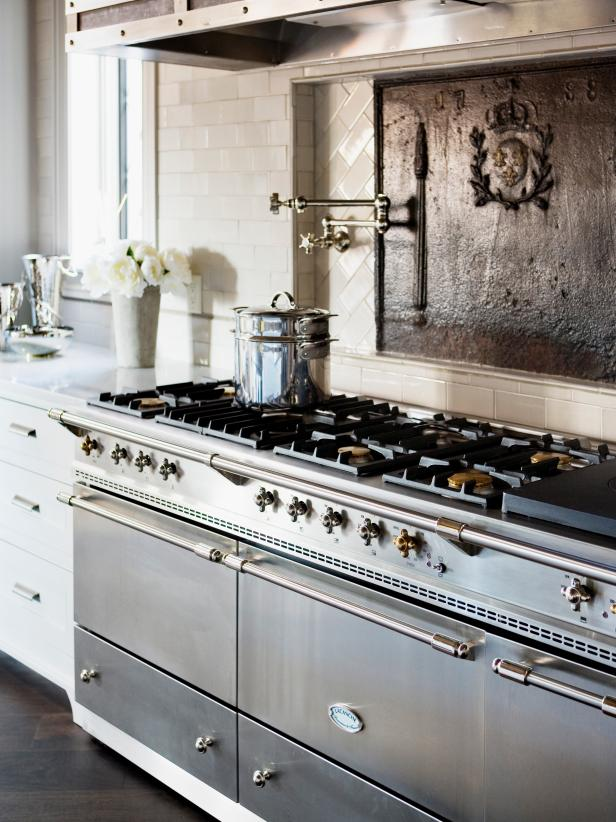 Steel and Nickel Range in Old World White Kitchen