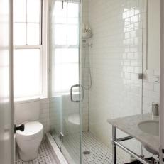 white subway and basket weave tile shine in classic bathroom