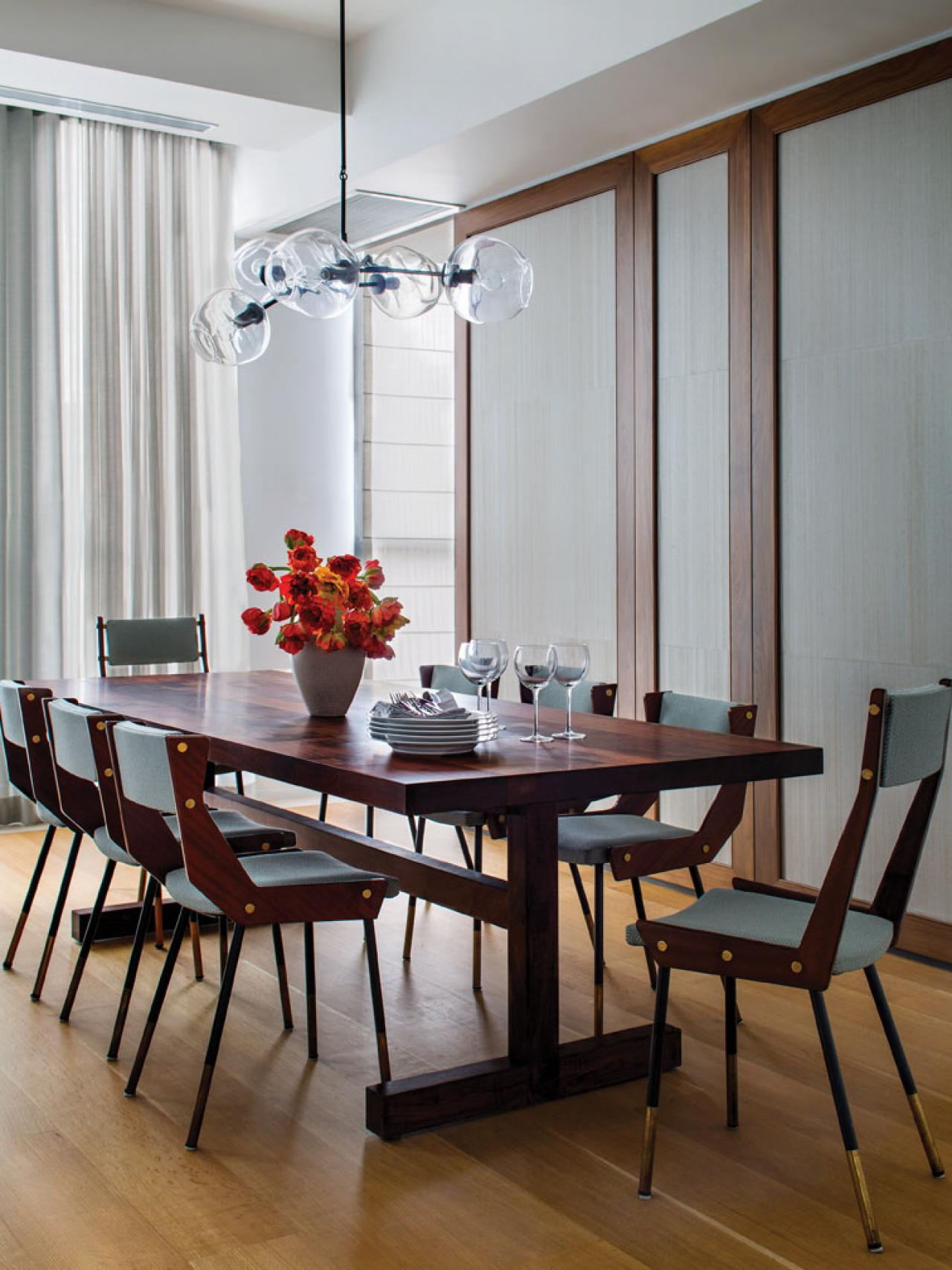 Midcentury Modern Dining Room With Globe Pendant Light
