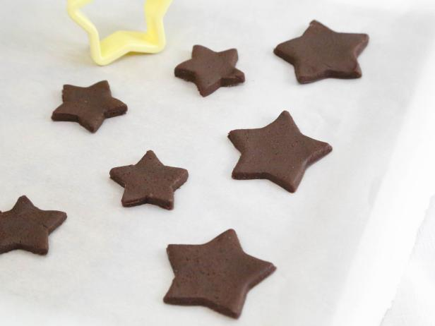 Cut out desired shapes from dough and transfer to prepared baking sheet.
