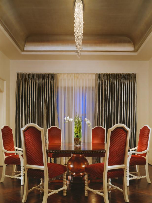 Dining Room With Traditional Round Dining Table and Red Chairs