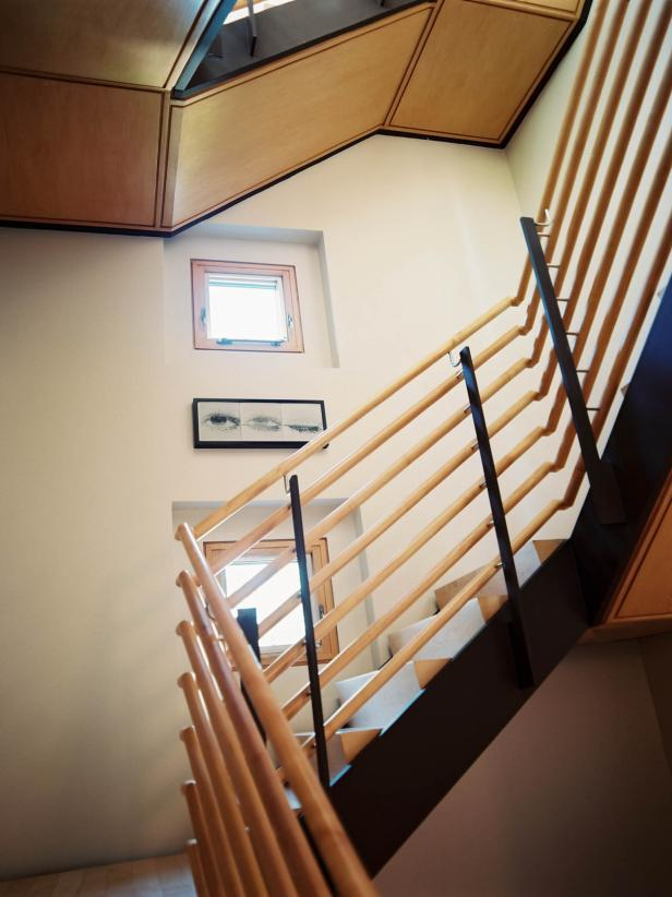 Modern Staircase With Light Wood and Multiple Railings
