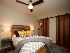 Master Bedroom With Distressed Barn Doors