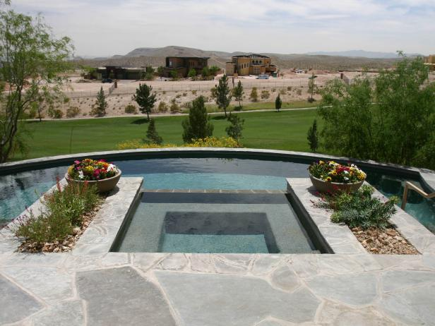 Pool with Raised Spa, Stone Planters and Golf Course View