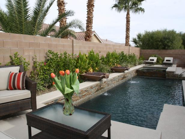 Patio and Natural Stone Pool With Fire and Water Features
